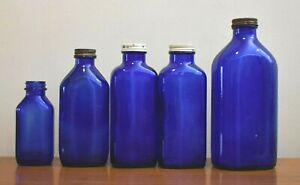 "Five Cobalt Blue Glass Milk Of Magnesia Bottles One 9"" Two 7 1/4"" One 7"" One 5"""
