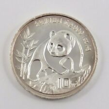 CHINA 1990 10 YUAN SILVER 9999 1 OUNCE COIN.  HAS TINY RIM NICKS. SEE PICTURES.