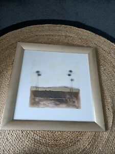 Gold and brown tree print in gold frame