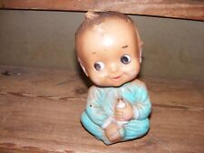 Vintage rubber baby doll happy  holding bottle squeak