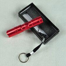 Linterna de aluminio, muy ligera, de color rojo, con correa y caja