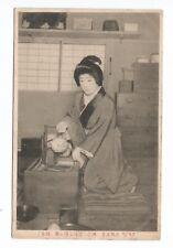 old Japan postcard, Geisha ?; woman preparing to serve tea