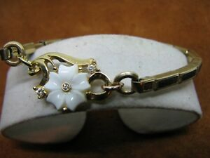 5-6 INCH GOLD FILLED N LEATHER BAND AND FLORAL CENTER PIECE, STRETCHY BRACELET