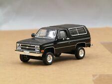dcp/greenlight Custom lifted 1989 black Chevrolet Blazer 1/64..