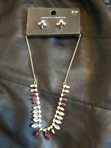 Dorothy perkins sparkly necklace and earrings set  with red and clear stones.New