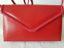 Italian red leather and authentic snakeskin trim; clutch/ snake shoulder strap