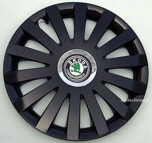 "Brand New black gloss  14"" wheel trims to fit  SKODA OCTAVIA, FABIA ,FELICIA"