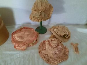 Box with four antique hats for dolls