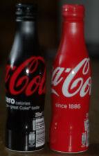 EXPORT 2016 Coca Cola 2 bouteilles rouge et noir capsule à visser neuves ,pleine