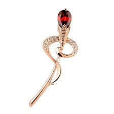 Broschen und Anstecknadeln aus Rotgold mit Perlen