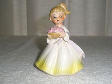 Vintage Girl Figurine Holds Basket of Goodies Yellow Dress Ponytail Japan