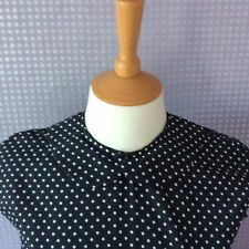 Black & white polka dot Peter Pan collar button back cap sleeve blouse
