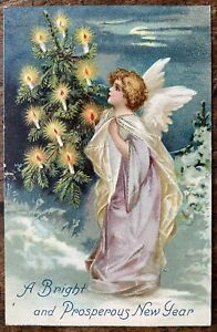 ANTIQUE EMBOSSED NEW YEAR GREETING PPC WINGED ANGEL HOLDING TREE WITH CANDLES