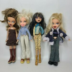 Lot of 4 Bratz With Clothes and Boots & Accessories