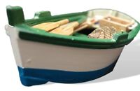 Model wooden rowing boat with lobster pot and oars