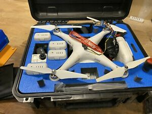 DJI Phantom 2 with Hero 3, gimbal, case, FOUR batteries, charger, screen & tools