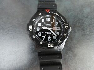 Casio MRW-200H mens black day date quartz watch with silicone strap working