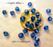 24 CAPRI BLUE SWAROVSKI CRYSTAL # 5301 BICONE BEADS 4MM