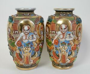 Pair of Japanese Satstuma pottery vases - high relief Immortals - signed
