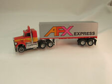 AURORA AFX PETERBILT WITH TRAILER W/RUNNING MAGNATRACTION LIGHTED CHASSIS ~ EXC!