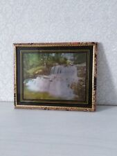 Picture framed. Waterfall, nature. Russia