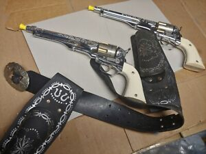 Two Hubley Colt 45 Cap Toy Guns with Belt holster