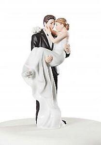 """White Porcelain Groom Holding Bride 6.25"""" tall wedding cake topper"""