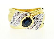 Anello in oro 18 kt con diamanti e zaffiro centrale