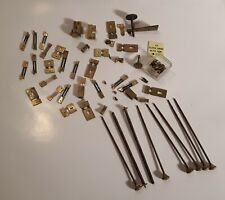 Lot suspension springs and various clock parts in box