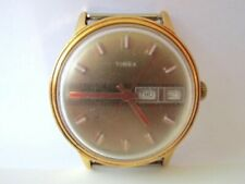 Timex day/date handwinder watch (runs a few seconds)