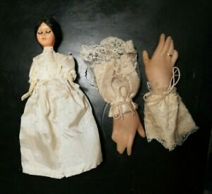 Vintage bride doll and two (possibly) candy hands with lace cuffs