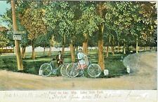 Fond du Lac WI Cycling Couple at Lake Side Park $5 Fine for horses tied to Trees