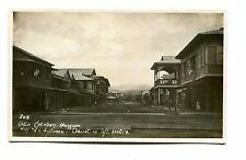 Vintage Postcard RPPC OLONGAPO PHILIPPINES Calle Esteban Navy Yard in distance