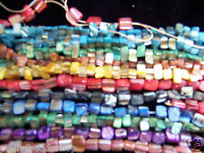 "A string of 16""  nuggets shell beads, 8 mm, in various colours*"