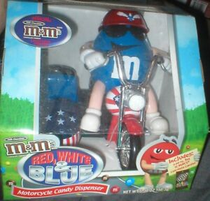 M & M MOTOCYCLE CANDY DISPENSER, RED WHITE AND BLUE, NEVER OPENED.