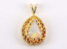 14k 2 Carat Fiery Opal in Detailed Quality Setting
