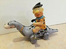 1962 MADE IN JAPAN  MARX TIN WINDUP FRED FLINTSTONE ON DINO TOY- VERY CUTE