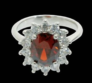 ISBN- RS-JANUA-M-CZ  Silver Plated Garnet and Clear CZ Ring, £95.00 Each