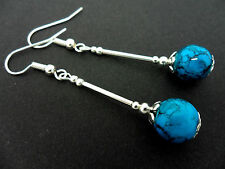 A PAIR OF  LONG DANGLY TURQUOISE BEAD EARRINGS. NEW.