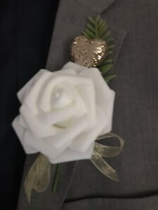 White Rose Button Hole With Fern , Light Gold Ribbon And Heart. Wedding Flowers.
