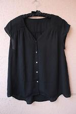 Schwarze Bluse mit Lamellen an Schultern, ca Gr. XL aufwärts