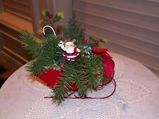 Vintage Red Metal Sleigh With Artificial Christmas Decor And Santa Claus