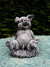 Stone / concrete garden statue ornament of a laughing pig