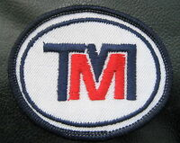 """T M EMBROIDERED SEW ON PATCH INITIALS 2 1/4"""" x 2"""" oval"""