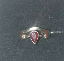 White gold ruby and diamond engagement ring and made to match wedding band