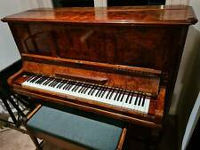 Ronisch upright pianola with rolls