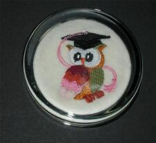 A new glass paperweight with machine embroidered owl with mortar board - boxed .