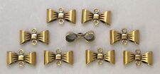 #1796 ANTIQUED GOLD 3-D BOW CONNECTOR W/2 RINGS - 12 Pc Lot