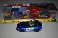 2019 JADA Die-Cast Metals 1/32 Transformers Optimus Prime and Barricade lot.
