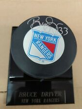 Bruce Driver Autographed Puck. Steiner.